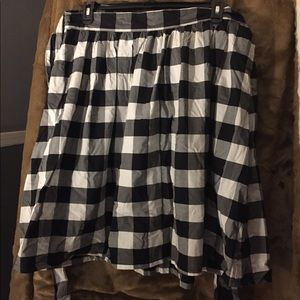 Black and white checked skirt.